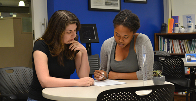Two students in a tutoring session.