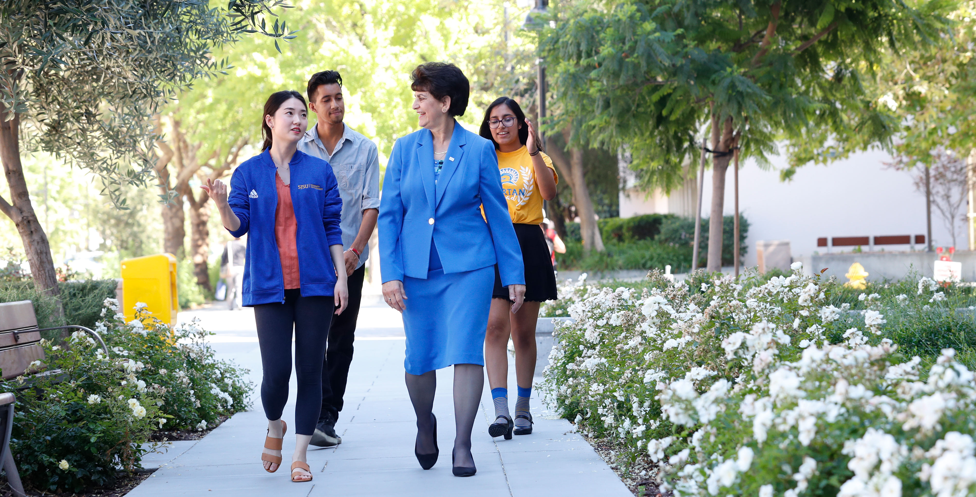 President Mary A. Papazian walking with SJSU students.