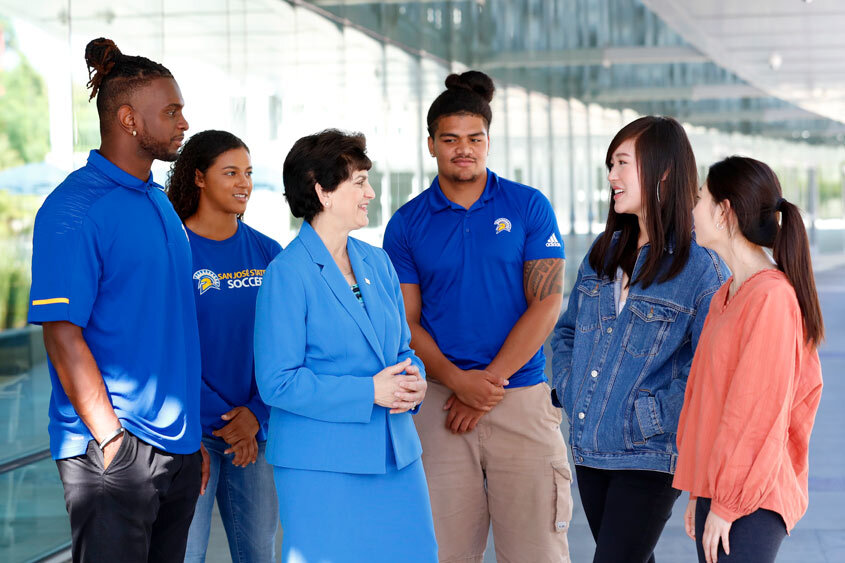 President Mary A. Papazian speaking with students.