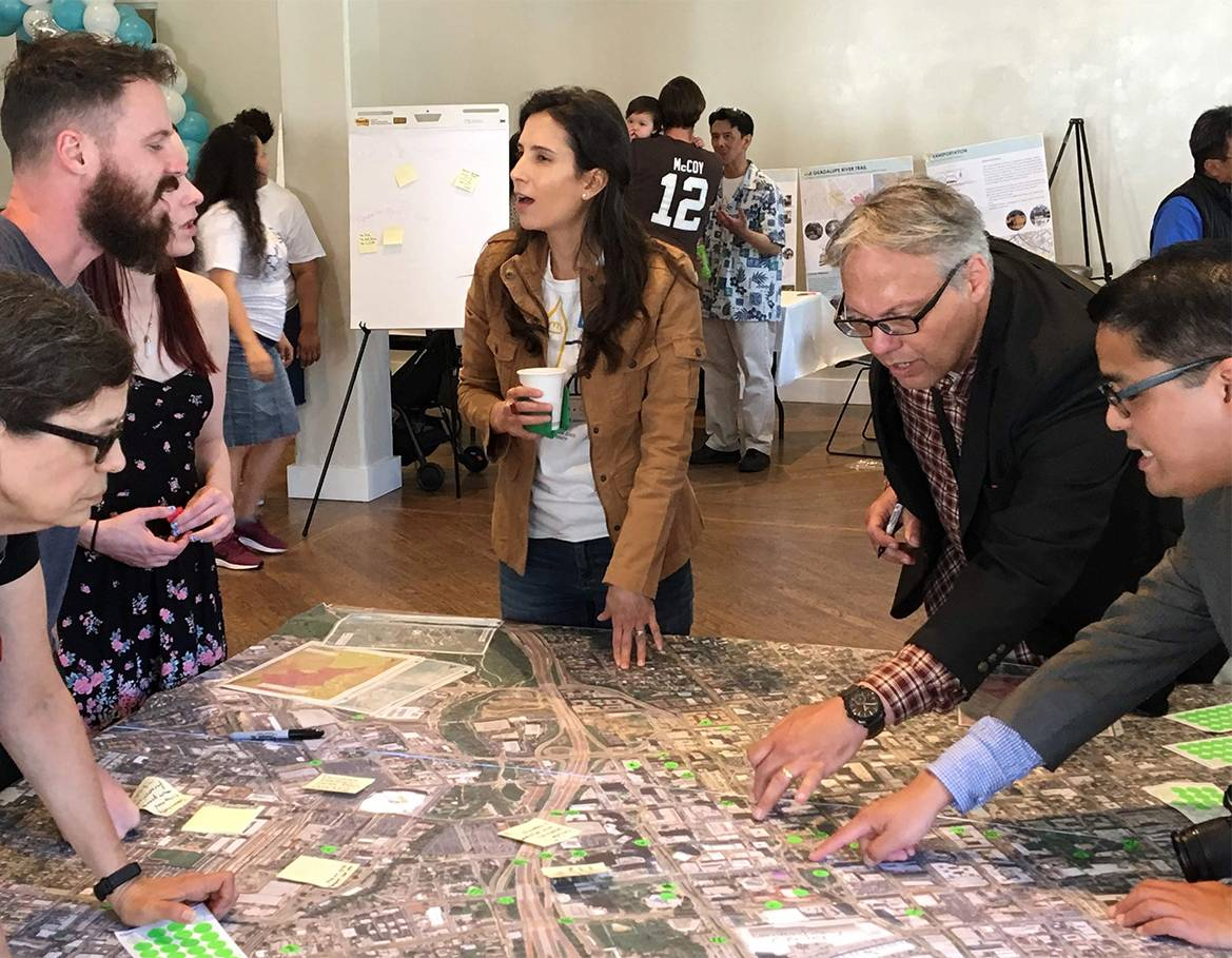 Students and community members review plans